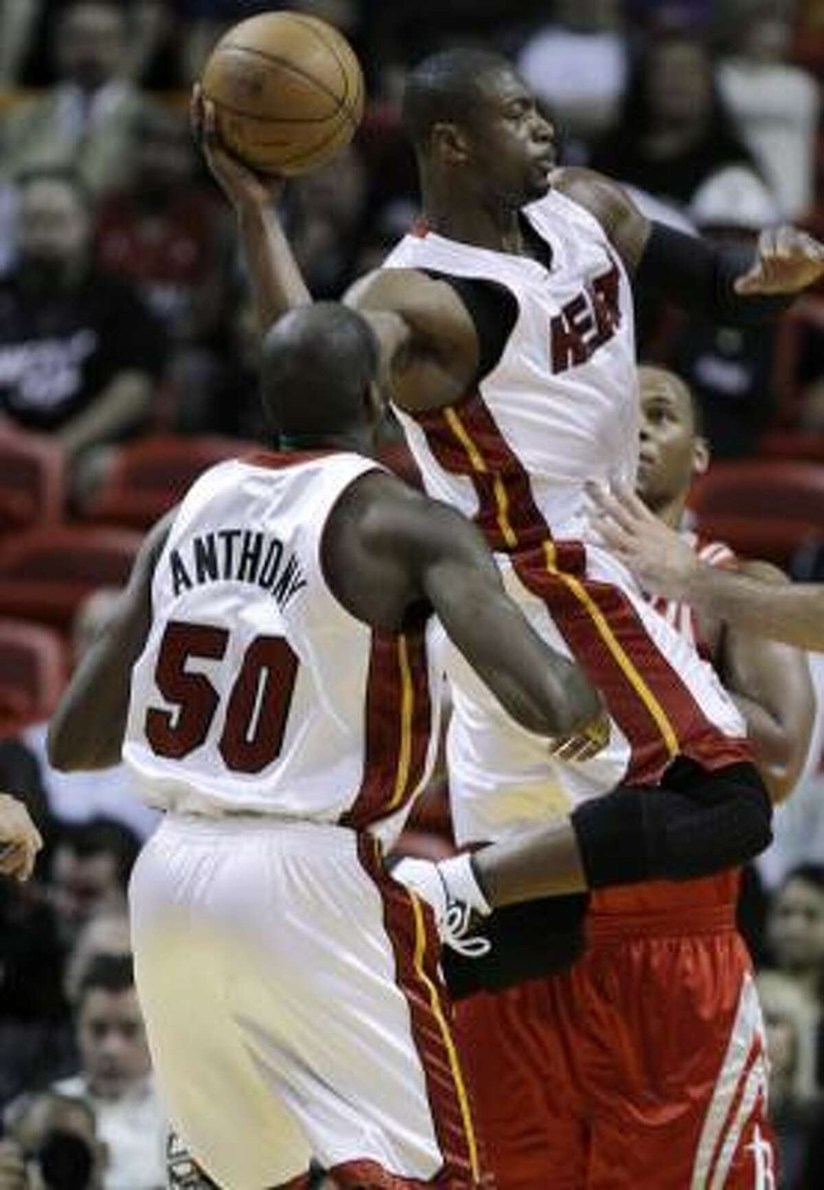 Miami Heat guard Dwyane Wade passes the ball as center Joel Anthony looks on in the first quarter. The Heat built an eight-point lead after one and would build on it from there.