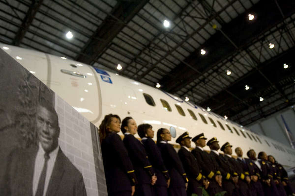A group of Continental Airlines African American pilots and flight attendants gathered for a press conference in front of a 737 that was named after Capt. Marlon Green (pictured left), the first African American commercial pilot.