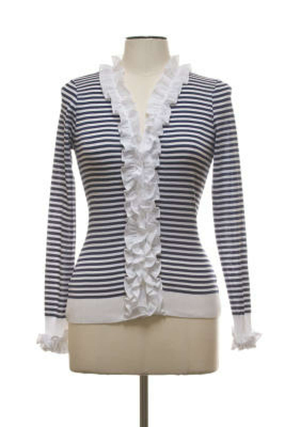 A striped sweater from Anne Fontaine's spring 2010 collection. Pair it with snappy espadrilles and white or navy jeans. Add a touch of red to make it nautical. And grab a colorful purse.
