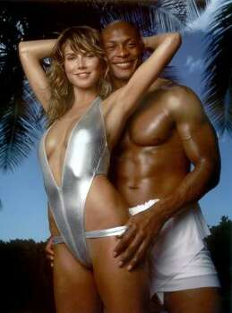 Some past shoots include Heidi Klum. Here she is with Tennessee Titans runningback Eddie George for the 2001 edition. Photo: AP