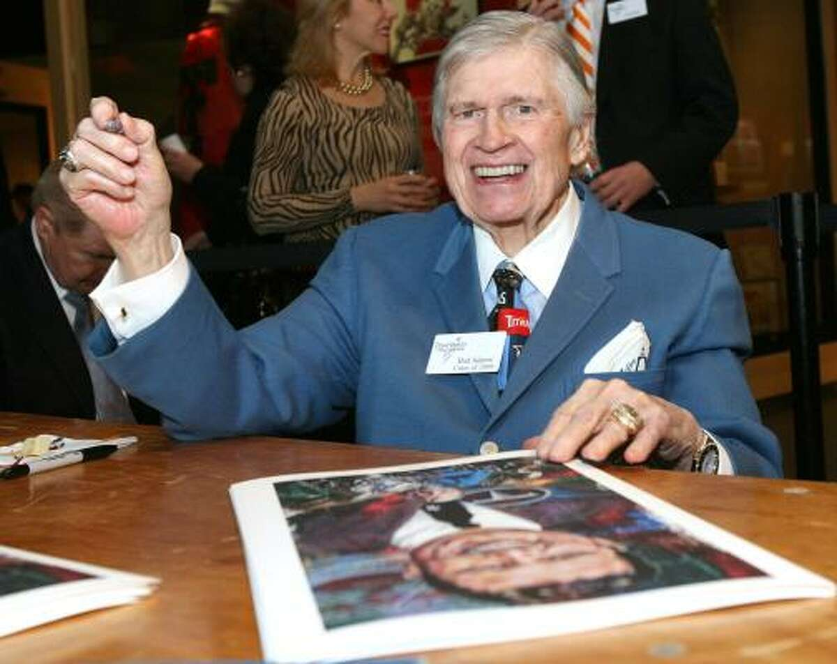 Tennessee Titans and former Houston Oilers owner Bud Adams Jr. signs autographs during the induction activities.