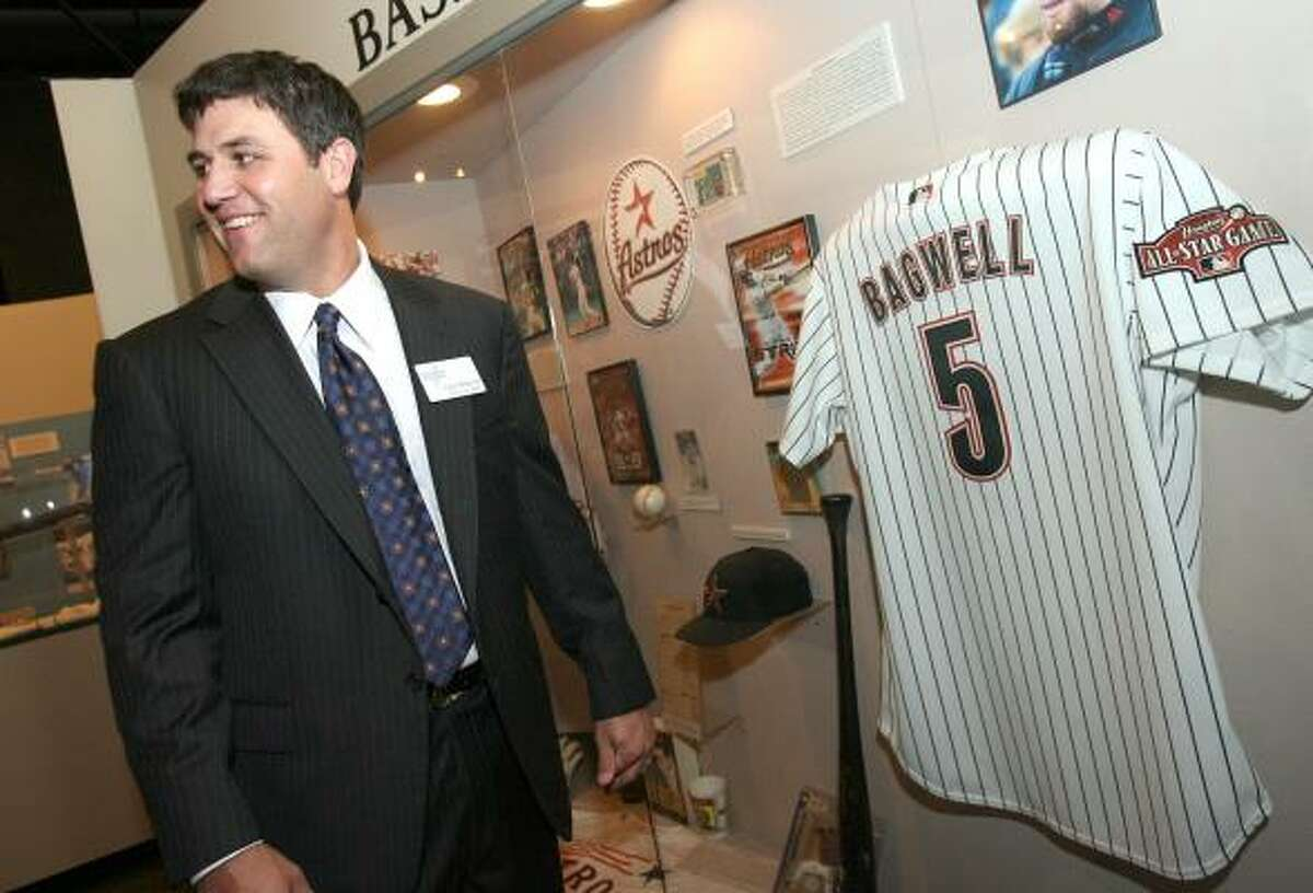 Inductee Lance Berkman looks over the Astros memorabilia exhibit before the ceremony.