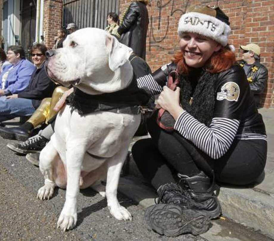 Denise Heston and Stitch wait for the Mystic Krewe of Barkus parades to march through the streets of the French Quarter in New Orleans Sunday. Photo: Bill Haber, AP