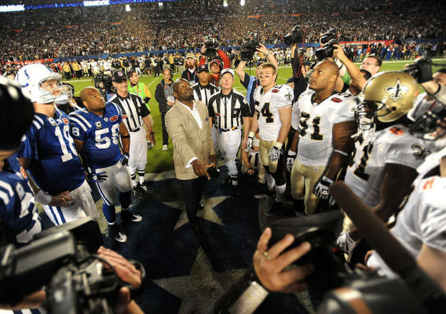 University of Florida alumni and NFL star Emmett Smith does the coin flip before Super Bowl XLIV. Photo: Jim Rassol, MCT