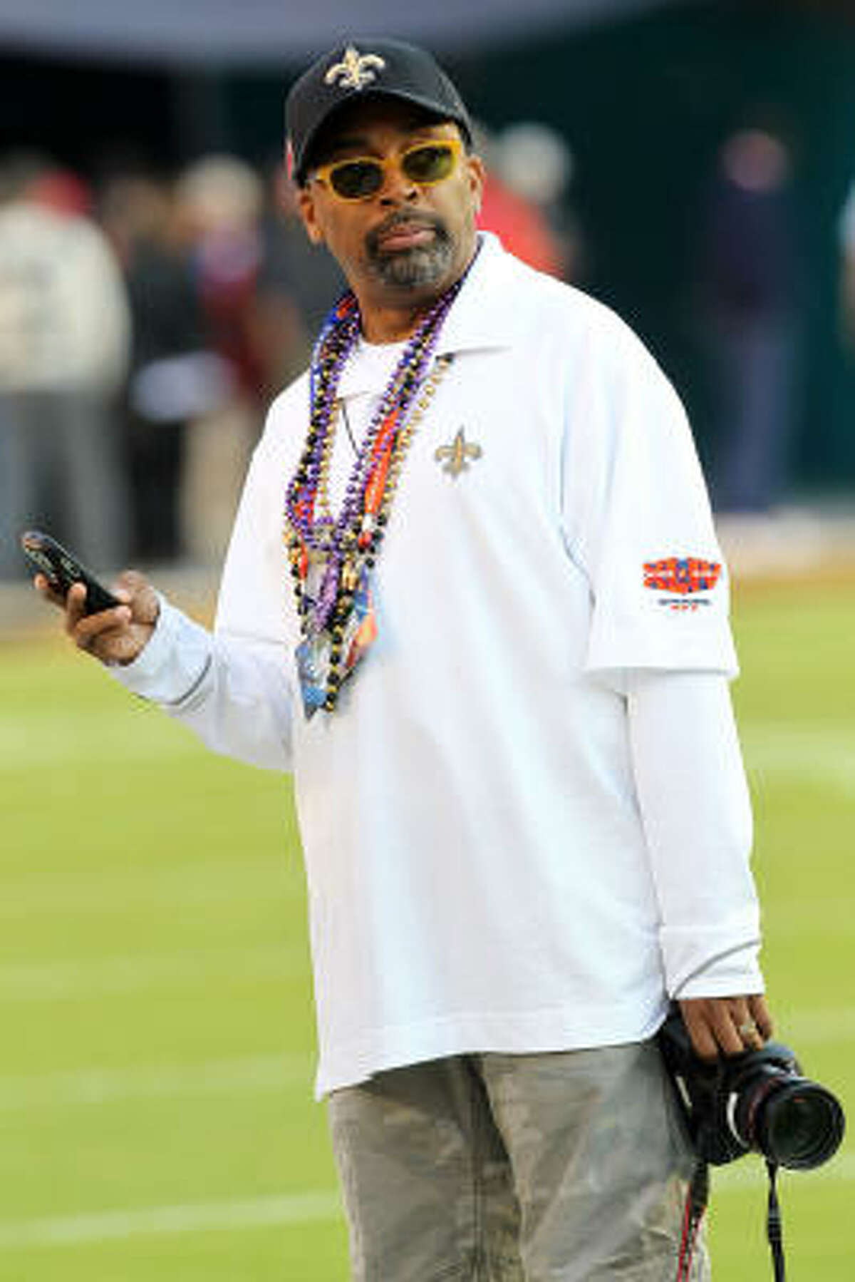 Director Spike Lee watches warms-ups on the field prior to the start of Super Bowl XLIV.