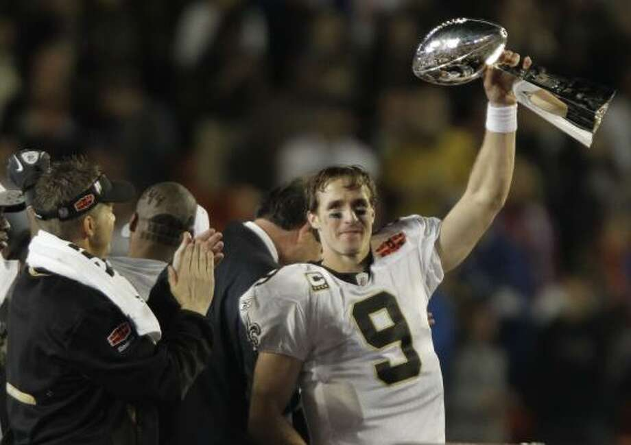 Saints quarterback Drew Brees, named the Super Bowl's most valuable player, holds the Lombardi Trophy. Game story Photo: Chris O'Meara, AP