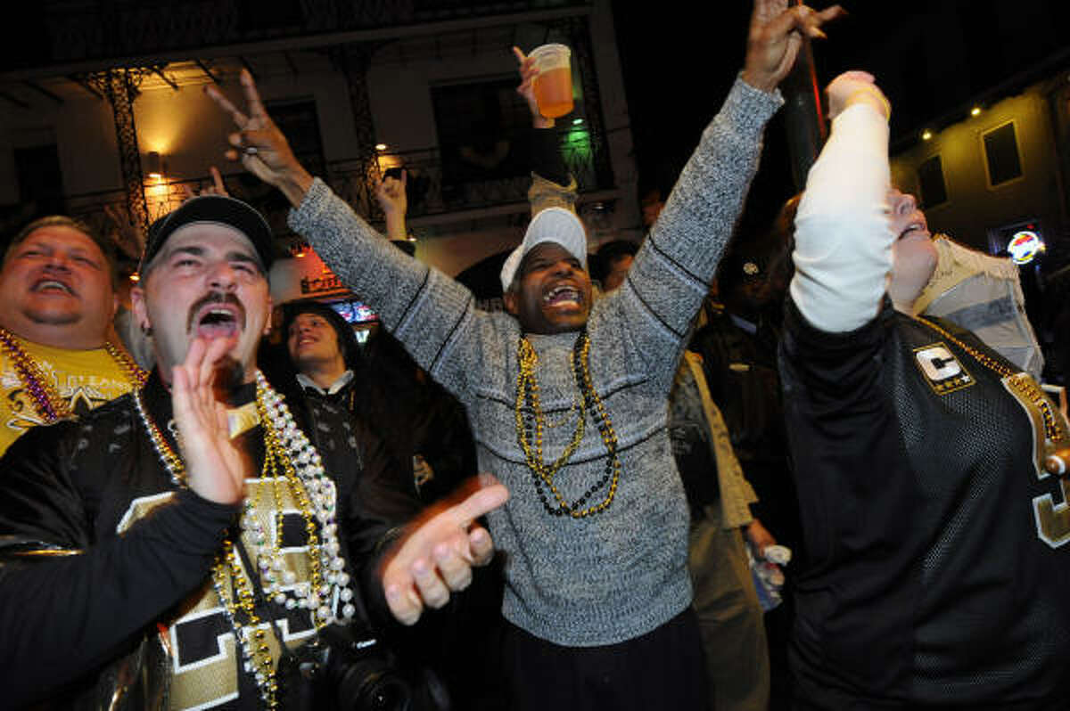 Fans celebrate the Saints' victory on Bourbon Street in the French Quarter.
