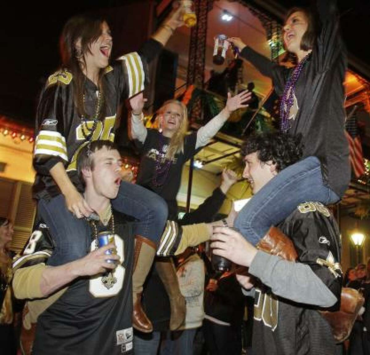 Fans reach new heights as they celebrate in New Orleans.