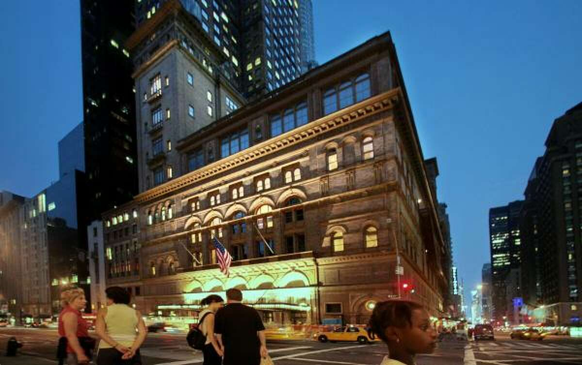 Carnegie Hall building at 57th Avenue and Broadway in New York, is shown on Friday. Fifty tenants, mostly artists, living and working in the towers above Carnegie's concert hall, have been served eviction notices in a move to renovate the existing space for other programs.