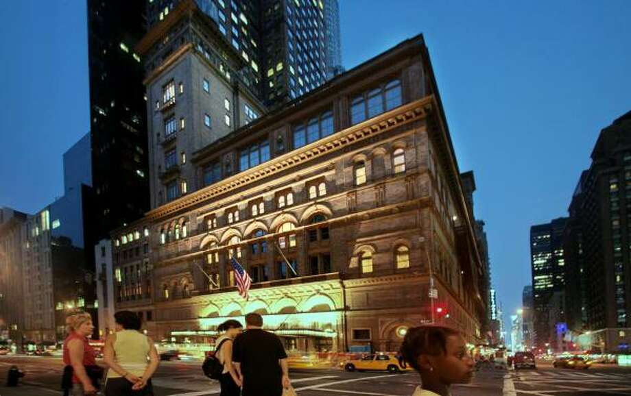 Carnegie Hall building at 57th Avenue and Broadway in New York, is shown on Friday. Fifty tenants, mostly artists, living and working in the towers above Carnegie's concert hall, have been served eviction notices in a move to renovate the existing space for other programs. Photo: Bebeto Matthews, AP