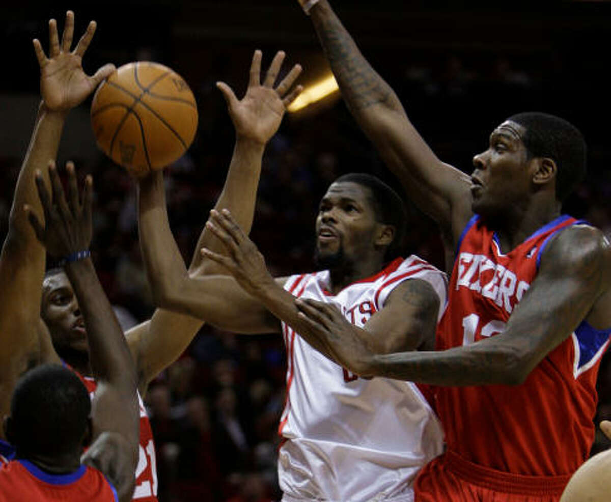 Rockets guard Aaron Brooks tries to navigate through a host of 76ers defenders.