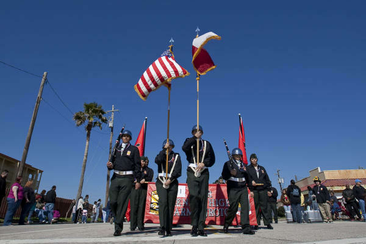 Furr High School's Army ROTC color guard lead the Mystic Krewe of Aquarius 25th Anniversary Parade along Seawall Boulevard on Feb. 6.