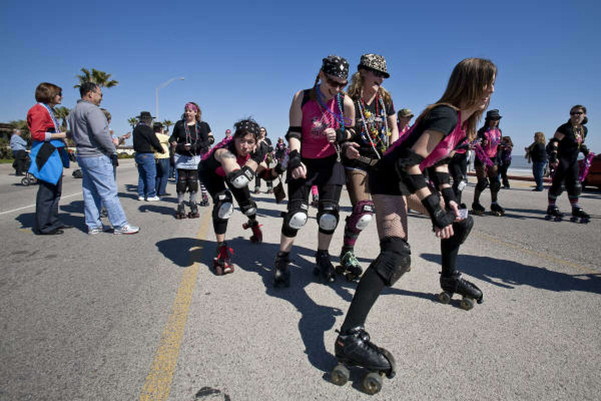 Houston Roller Derby skaters roll down Seawall Boulevard during the parade.
