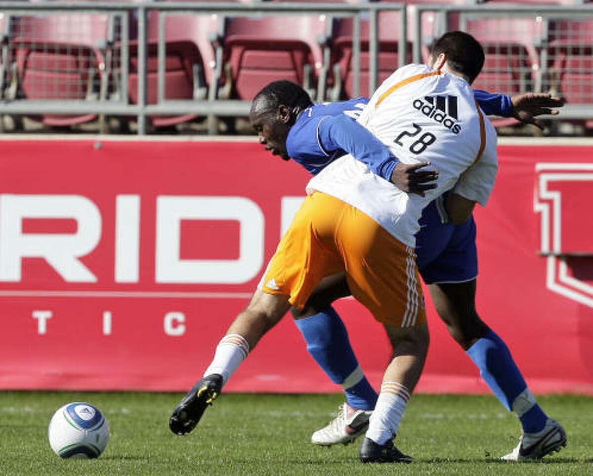 HBU's Duke Ogega, back, attempts to get around the Dynamo's Peter Maciel.