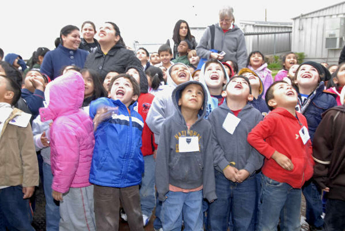 HANDS-ON LESSON: Bear Boulevard Pre-K students are amazed by a flock of birds maneuvering just over their heads at the Spring Branch ISD Ag Center Feb. 4.