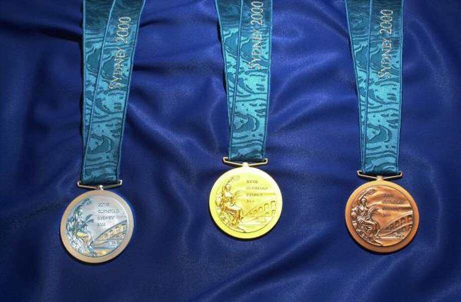 The silver, gold and bronze medals for the 2000 Olympics in Sydney, Australia. Photo: RICK RYCROFT, AP