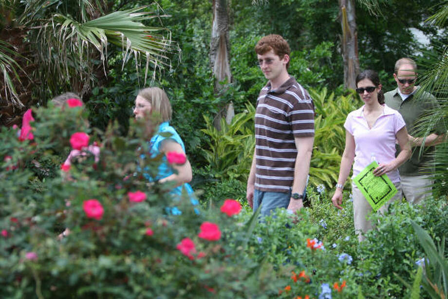 Visitors tour an oasis at 8710 Cypresswood at the Champion Forest Garden Club Backyard Garden Tour April 26, 2009. Garden tours on the calendar | More news from Spring | Submit your garden photos | HoustonGrows.com Photo: Thomas Nguyen, For The Chronicle