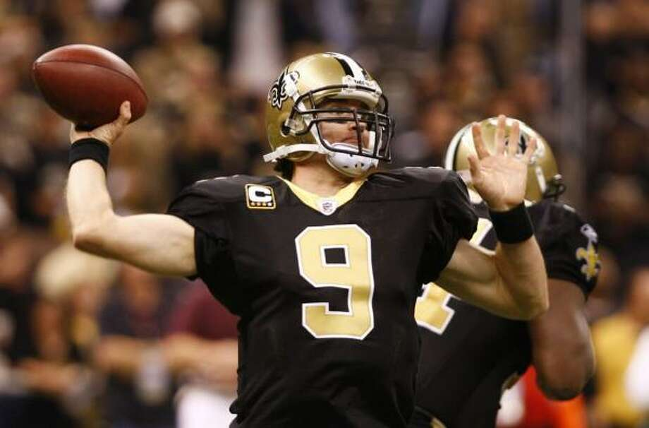 Nov. 30: Saints 38, Patriots 17Record:11-0  With one pinpoint throw after another, Drew Brees put New Orleans' pursuit of perfection into overdrive and left Tom Brady and the New England Patriots in the dust.  Brees threw for a season-high 371 yards and five touchdowns, carving up coach Bill Belichick's defense like few quarterbacks ever.  By harassing Brady all game and routing one of the NFL's top powers, the Saints joined the Indianapolis Colts at 11-0 — the first time two NFL teams have opened with that many consecutive wins in the same season.  Brees threw touchdown passes to five different players: Pierre Thomas, Devery Henderson, Robert Meachem, Darnell Dinkins and Marques Colston. In doing so, the Pro Bowl quarterback kept New Orleans on pace to narrowly eclipse New England's single-season scoring record of 589 points set in 2007.  Photo: Scott Halleran, Getty Images