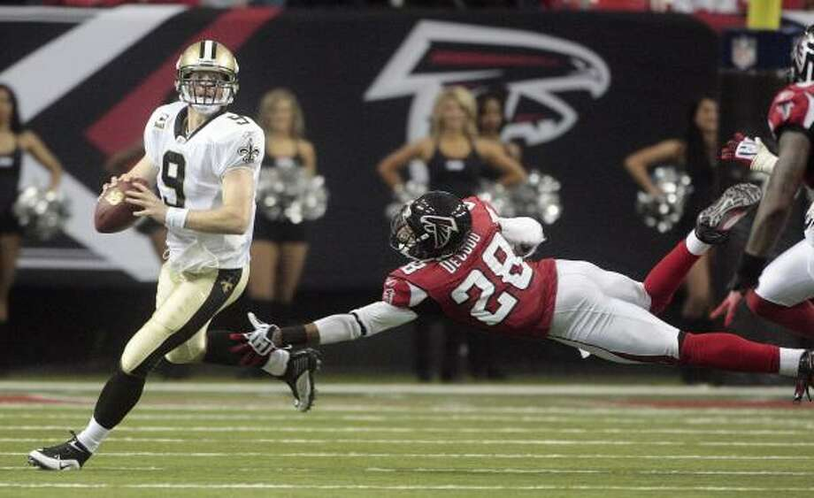 Dec. 13: Saints 26, Falcons 23Record:13-0  Drew Brees was 31 for 40 and threw for 296 yards and three touchdowns, Jonathan Vilma came up with two huge defensive plays, and New Orleans remained perfect with another tight win.  Garrett Hartley won it on a 38-yard field goal with a 4:42 remaining after Atlanta rallied from 14 points down. The offensive-minded Saints (13-0) then turned to defense to preserve another victory — Vilma came up with an interception, then doled out a big fourth-down hit on Jason Snelling to finish the Falcons' final drive.  New Orleans set a franchise record for wins in a season, clinched a first-round bye in the NFC playoffs.  Brees threw a pair of touchdown passes to Reggie Bush and another to Marques Colston.  The Falcons played without two of its biggest stars, quarterback Matt Ryan and running back Michael Turner, both out for the second week in a row.  New Orleans joined Indianapolis as one of seven NFL teams to reach 13-0. Photo: Dave Martin, AP