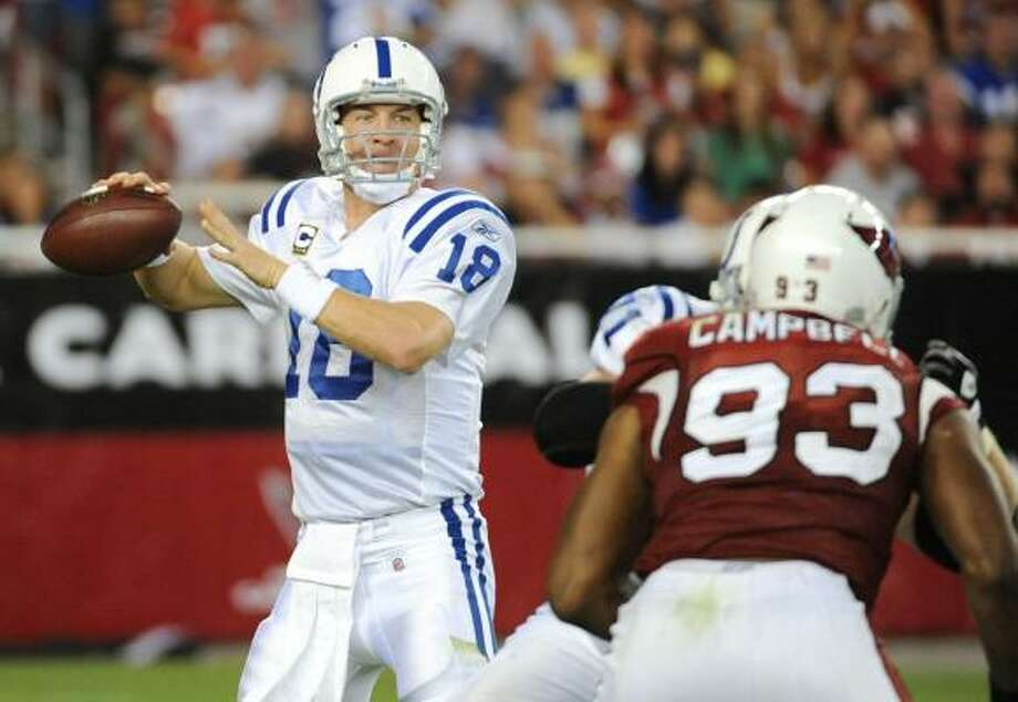 Sept. 27: Colts 31, Cardinals 10Record: 3-0  Peyton Manning threw four touchdown passes, three in the second quarter, to power Indianapolis.  Manning completed 24 of 35 for 379 yards with one interception. The Colts' quarterback had four TD passes in a game for the 18th time, moving him ahead of Johnny Unitas into third on the NFL career list, behind Dan Marino's 21 and Brett Favre's 20.  Kurt Warner, under severe pressure much of the night, was 30 of 52 for 332 yards and one score but was picked off twice.  Indianapolis (3-0) safety Antoine Bethea recovered a fumble at the 5-yard line to stop one Arizona (1-2) drive and intercepted a deflected pass in the end zone to thwart another. Photo: Harry How, Getty Images