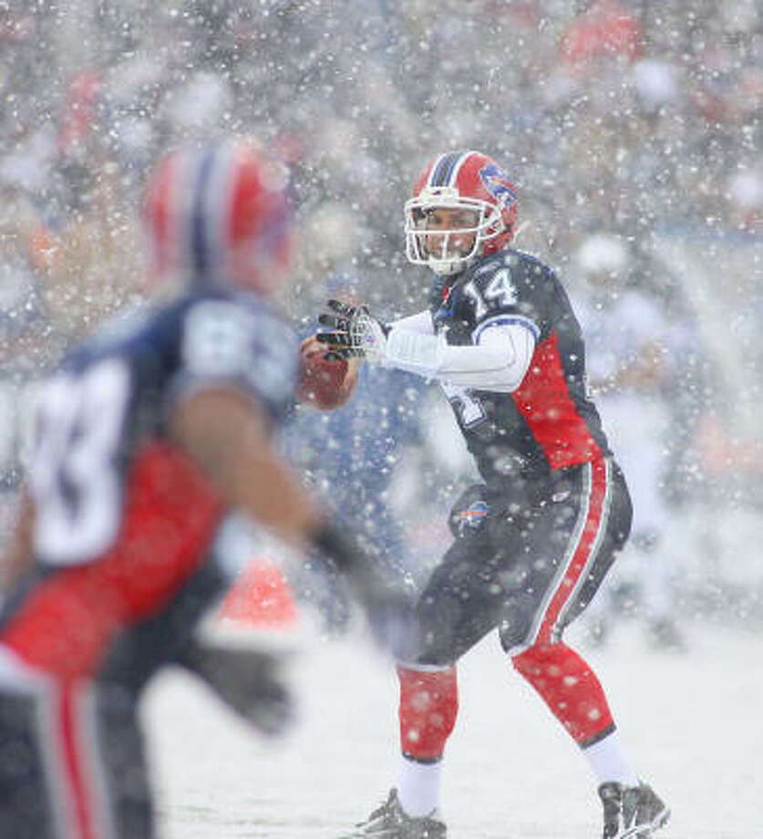 Jan. 3: Bills 30, Colts 7  Record: 14-2  Despite near whiteout conditions in the first half, Ryan Fitzpatrick threw three touchdown passes for Buffalo (6-10), including a 41-yarder to Terrell Owens.  Fred Jackson had 212 yards rushing to reach 1,000 for the first time in his career.  The Colts (14-2) rested numerous starters, including Peyton Manning, in the second quarter. They have a two-week break before opening the playoffs as the AFC's top-seeded team.  The Colts squandered a chance to become the sixth NFL team to win 15 games in one season and also had a franchise-best 11-game road win streak snapped.  Dallas Clark became the NFL's second tight end to have a 100-catch season, joining Tony Gonzalez, and Reggie Wayne had five catches to reach 100 for the second time in his career. Photo: Rick Stewart, Getty Images