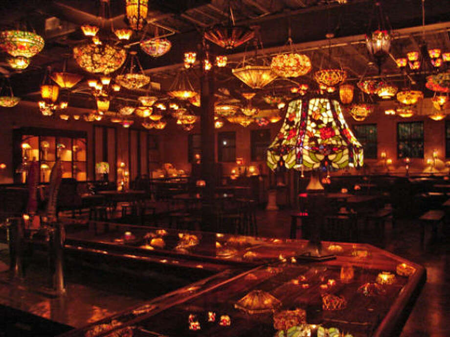 Nouveau Antique Art Bar: There's nothing like this gorgeous bar in Houston. With its scores of Tiffany-replica fixtures, the ceiling is an impressionist painting of light. It's, very simply, the most romantic spot in Houston. 2913 Main, 713-526-2220, art-bar.net. Photo: Nouveau