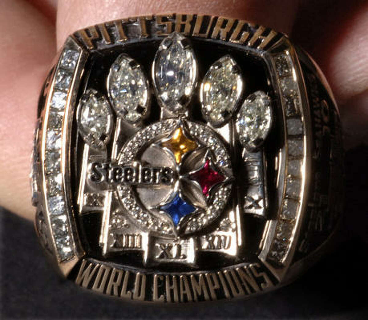 This is one of the National Football League Pittsburgh Steeler Super Bowl rings shown Sunday, June 4, 2006, during a ceremony at Heinz Field in Pittsburgh, Pa. Team owner Dan Rooney, retired running back Jerome Bettis and quarterback Ben Roethlisberger designed the ring. The yellow gold ring features five diamond Vince Lombardi trophies surrounding the Steelers' logo on the front. One side features a player's name and number; the other shows the game's 21-10 score and the numeral XL. The Steelers defeated the Seattle Seahawks in Super Bowl XL in Detroit in February. (AP Photo/Pittsburgh Post-Gazette, Peter Dian) * MAGS OUT NO SALES **