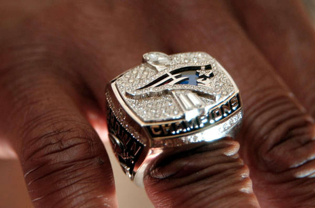 Troy Brown shows off his Super Bowl XXXVI championship ring after a ceremony in Boston, Sunday, June 9, 2002. The 14-karat white gold ring, with a total of 143 diamonds, blue sapphires and red garnets, weighs 3 ounces.