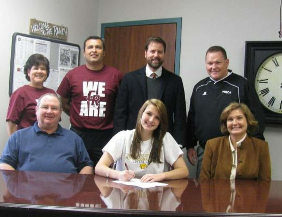 Cinco Ranch midfielder Missy Wentz signs with Southern Mississippi. Wentz is surrounded by her family and coaches.