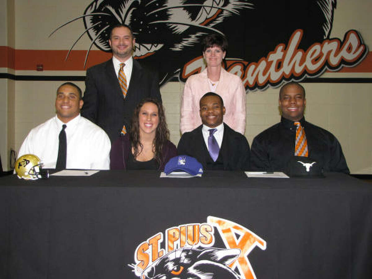 Four St. Pius X High School athletes accepted athletic scholarships on National Signing Day on February 3. From left to right, defensive end Kirk Poston signed with the University of Colorado, catcher Samantha Wursteisen signed with Millsaps College, running back and receiver Venric Mark signed with Northwestern University and defensive end Greg Daniels signed with the University of Texas.