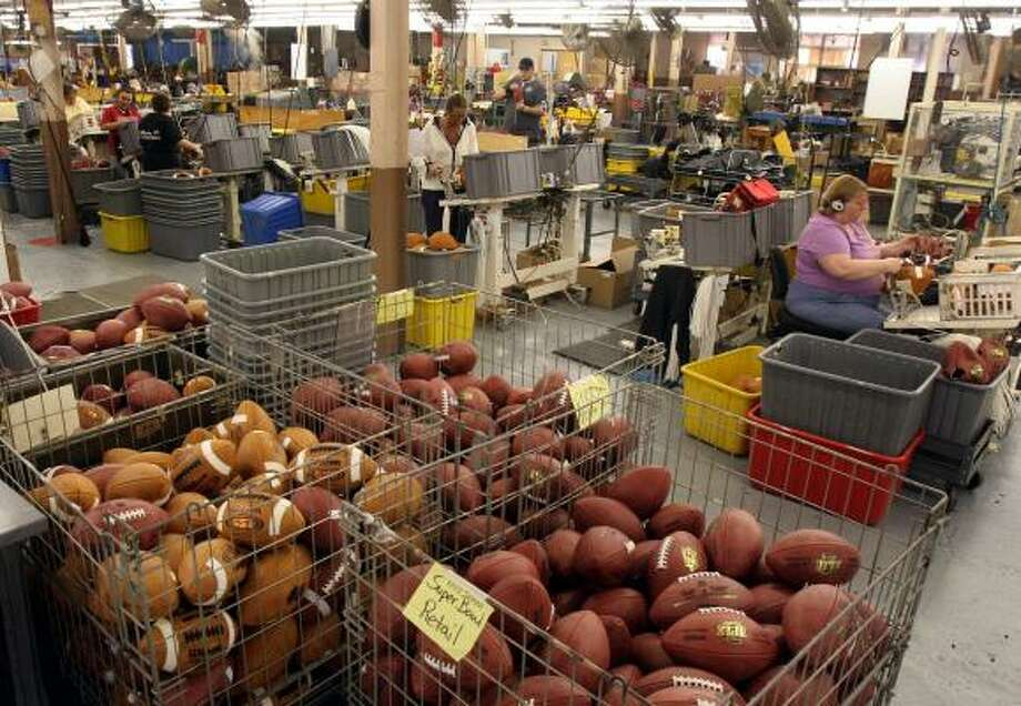 "The Wilson Sporting Goods football factory in Ada, Ohio, is the only football manufacturing plant in the United States. ""Every point scored in the NFL since 1941 has been with a Wilson football,"" a Wilson spokesman said. ""We're all very proud of that fact."" Photo: Skip Peterson, AP"