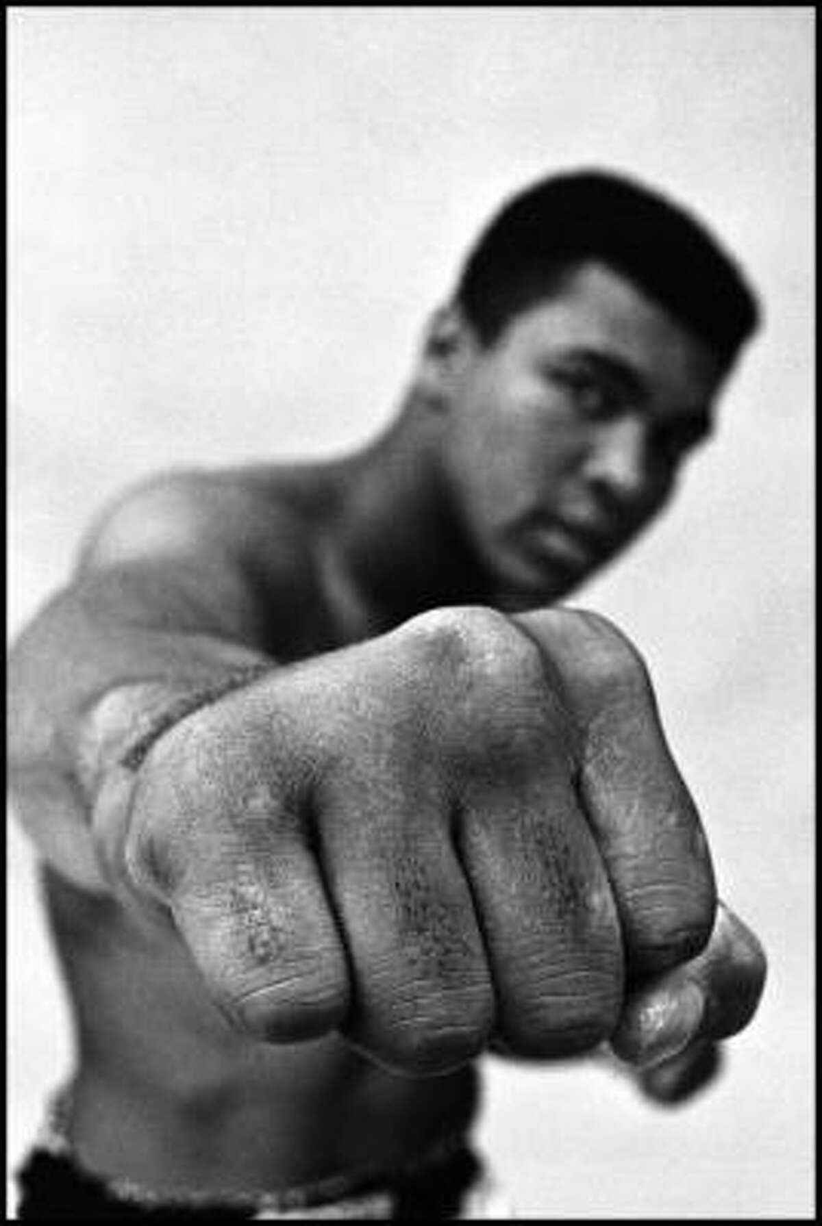 Muhammad Ali, boxing's world heavyweight champion showing off his right fist, Chicago, 1966.