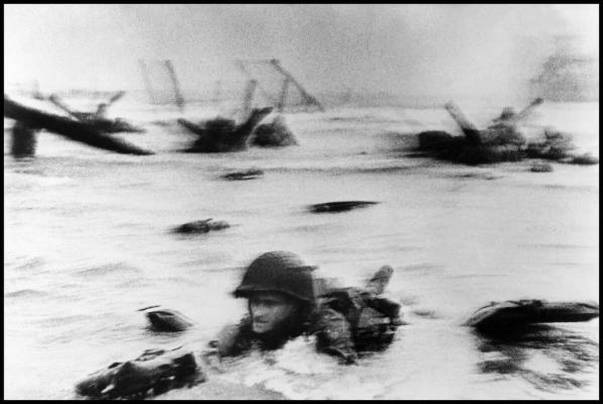 The first wave of American troops lands at dawn on Omaha Beach on June 6th, 1944.