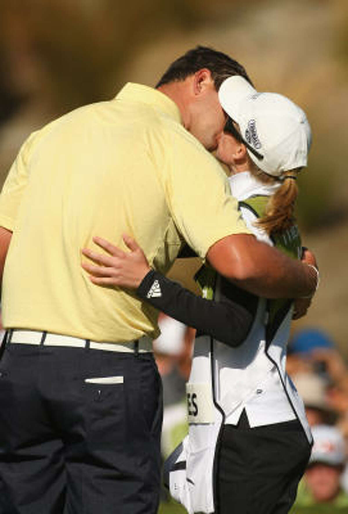 Bobby Gates' caddy is also his girlfriend, Lauren Johnson.