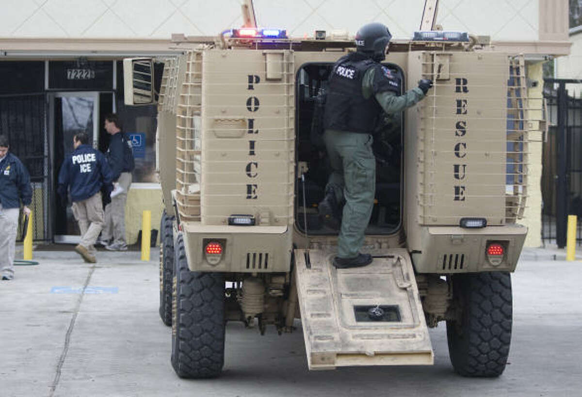 Agents accompanied by a helicopter and an armored Department of Homeland Security vehicle swarmed the Long Drive site around 9 a.m.