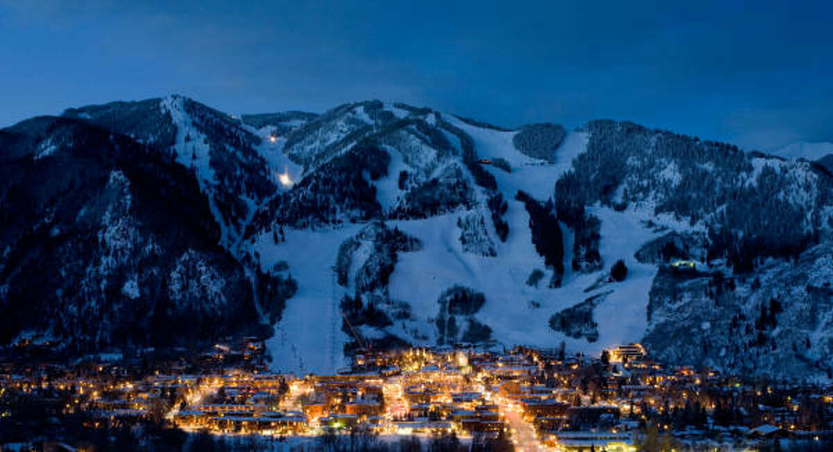 Moonlight glows on Aspen Mountain and the town below.