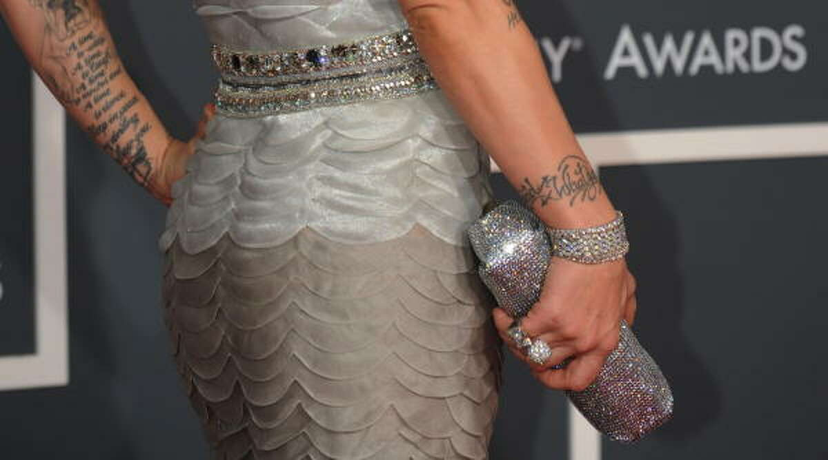 Pink carried a clutch with a sparkly bracelet.