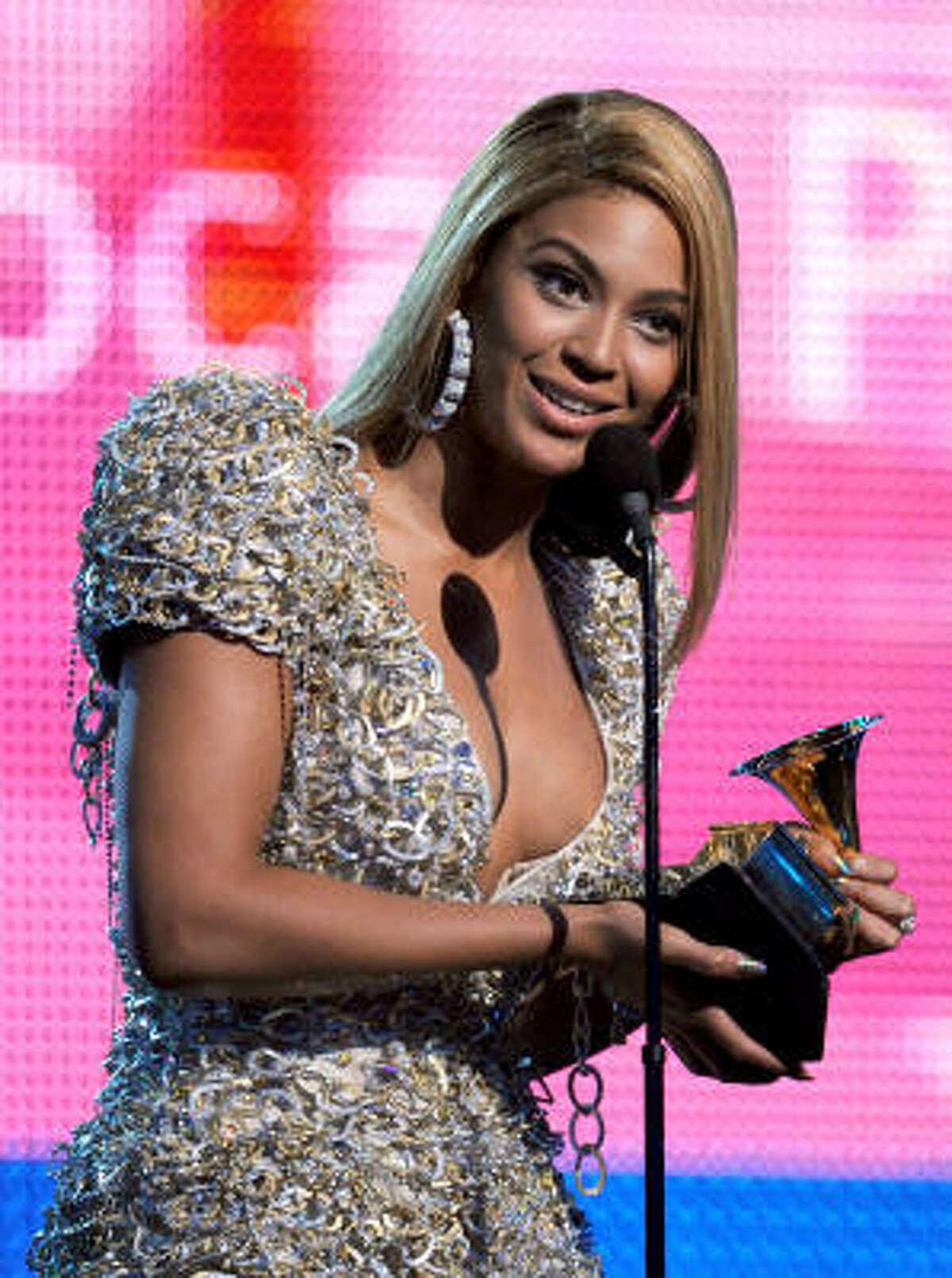 Beyonce Knowles accepts the Best Female Pop Vocal Performance award onstage during the Grammy awards show.