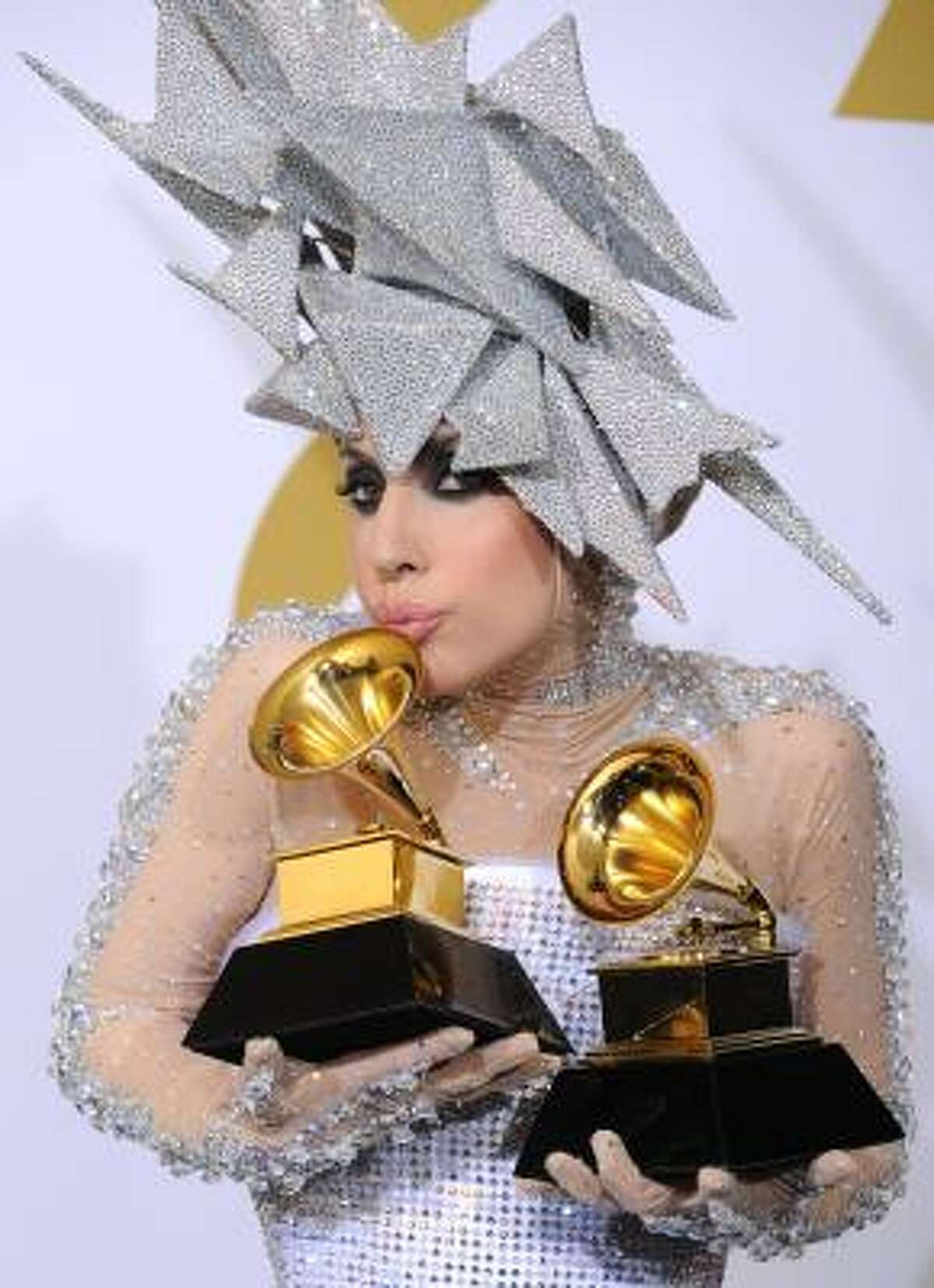Lady Gaga kisses her awards for Best Dance Recording and Best Electronic Dance Album.