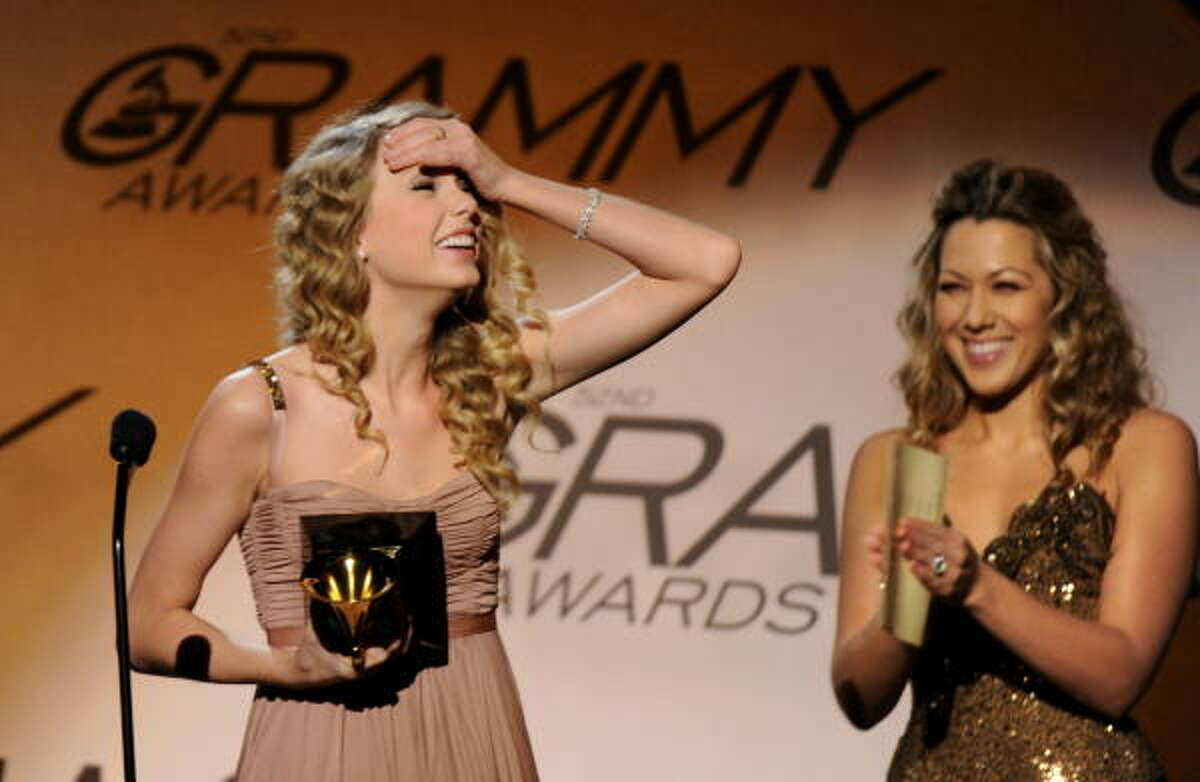 Taylor Swift is presented with the Best Female Country Vocal Performance award for