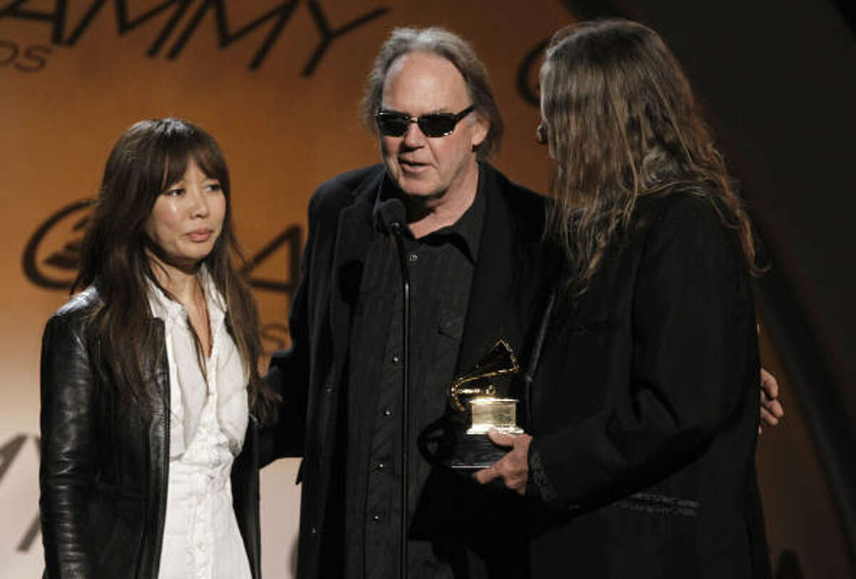 Jenice Heo, left, Neil Young, center, and Gary Burden accept the award for best boxed or limited edition for