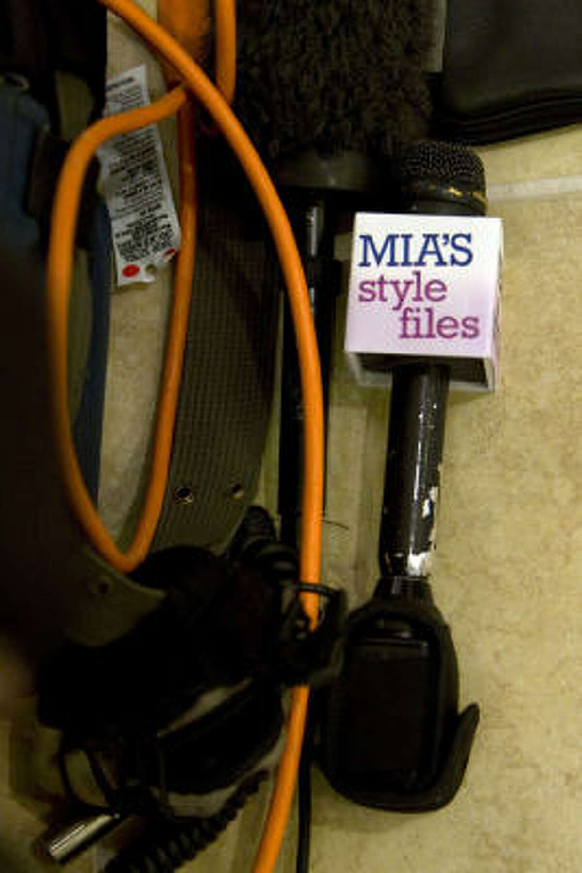 Gradney's microphone sits on the floor while she shoots a segment for Mia's Style File.