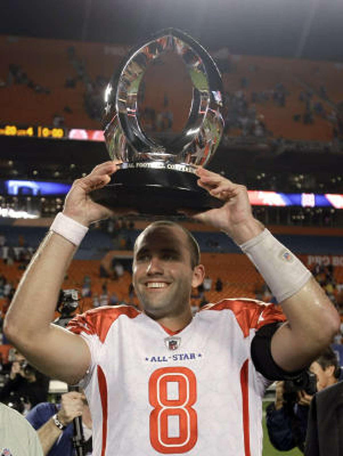 Texans quarterback Matt Schaub (8) holds up his MVP trophy.
