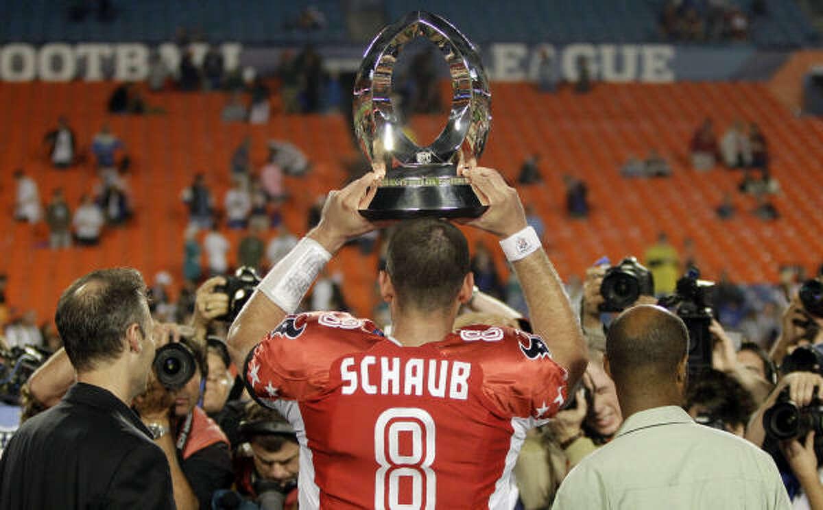 Texans quarterback Matt Schaub holds up his MVP trophy.
