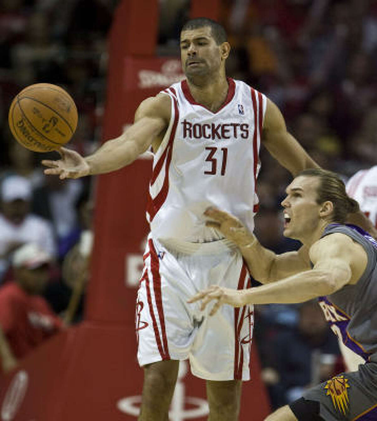 Rockets guard Shane Battier and Suns center Louis Amundson (right) chase a loose ball during the fourth quarter.