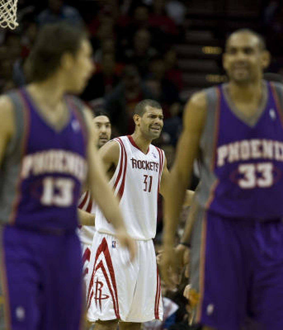 Rockets guard Shane Battier reacts to a call as Suns guards Steve Nash (left) and Grant Hill (right) walk away during the fourth quarter.