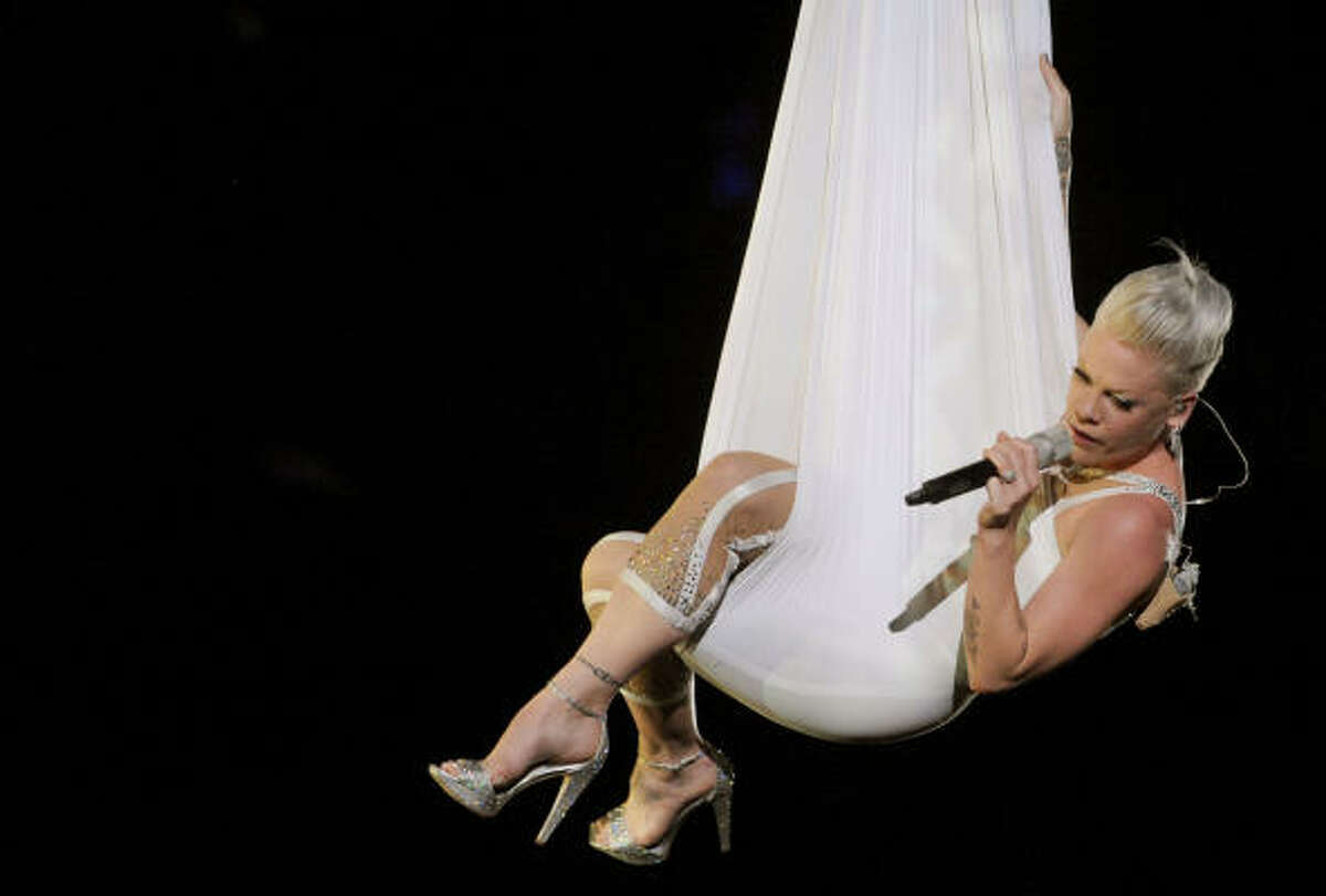 Pink was lowered onto the stage by a big white sheet for her performance.