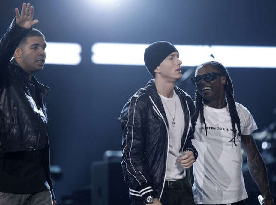 Much of the performance by Drake, Eminem, and Lil Wayne was seen but not heard because of profanity. Photo: Matt Sayles, AP