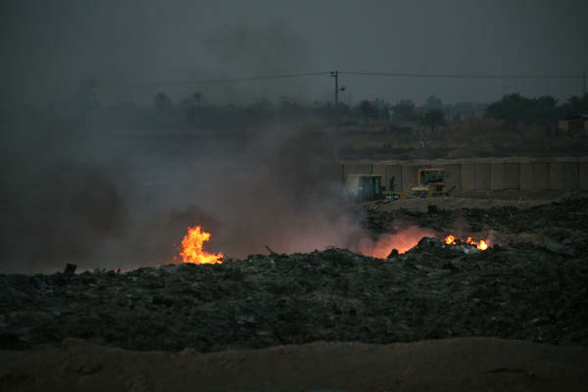Flames flare out of a burn pit at Camp Taji, north of Baghdad, at Camp Taji, north of Baghdad.