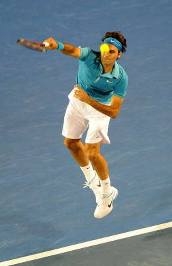 Roger Federer plays a forehand return in the match he won in straight sets. Photo: TORSTEN BLACKWOOD, AFP/Getty Images